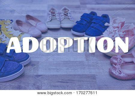 Adoption concept. Children shoes on floor