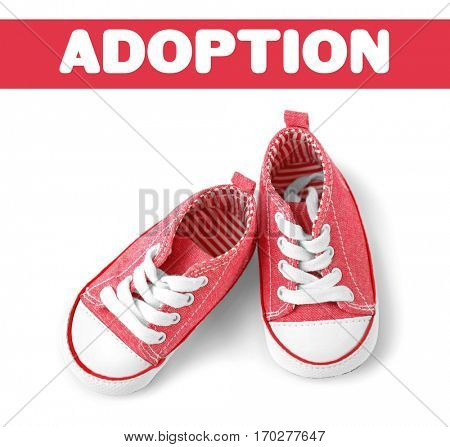 Adoption concept. Baby shoes on white background