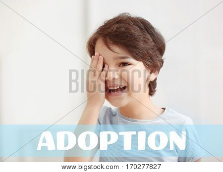 Adoption concept. Happy little boy at home