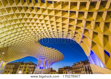 Seville, Spain - 2 November 2016: Metropol Parasol in Plaza de la Encarnacion. J. Mayer H. architects, it is made from bonded timber with a polyurethane coating