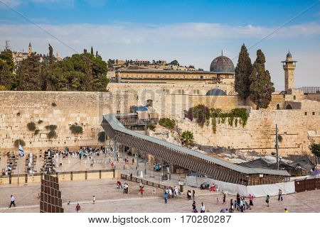 The area in front of the greatest shrine of Judaism. The Western Wall of the Temple is preparing for evening prayer.  Autumn holiday Sukkot