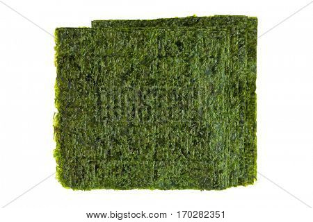 Sheet of dried roasted green seaweed (Nori), main ingredient to cook Asian, Japanese food isolated on white background