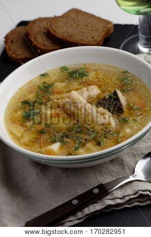 Burbot fish soup with vegetables and dill