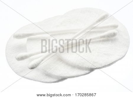 Cotton swabs and cotton pads on a white background.