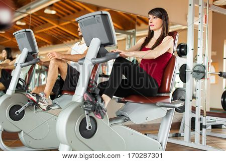People working out on a stationary bike