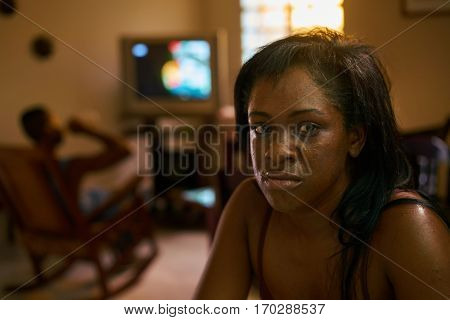 Social issue abuse and violence on women drunk hispanic man and sad black woman crying at home. Violent husband and abused wife