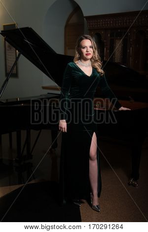 Portrait Of Beautiful Woman With The Piano