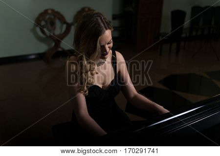 Portrait Of Woman Playing Piano
