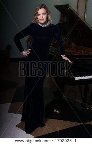 Portrait Of Woman With Piano