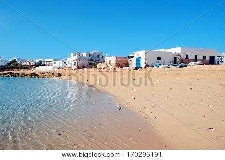 a view of a white sand cove in Caleta del Sebo in La Graciosa, Canary Islands, Spain