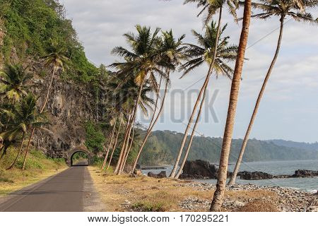 Road to the north of Sao Tome Island, with a historical tunnel and beautiful sea.