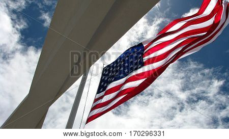 US Flag over USS Arizona Memorial at Honolulu, HI