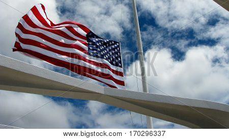 American flag flying over the USS Arizona Memorial in Honolulu, Hawaii
