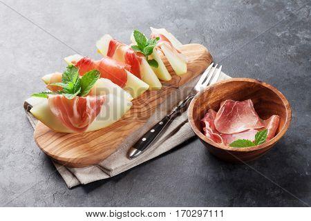 Fresh melon with prosciutto and mint. Antipasti