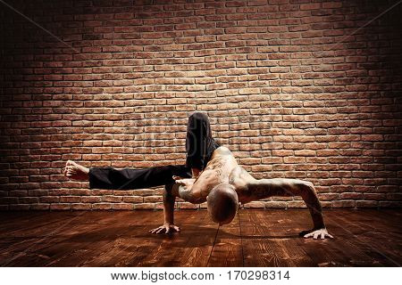 Various difficult yoga poses. Yoga teacher doing exercises on yoga.