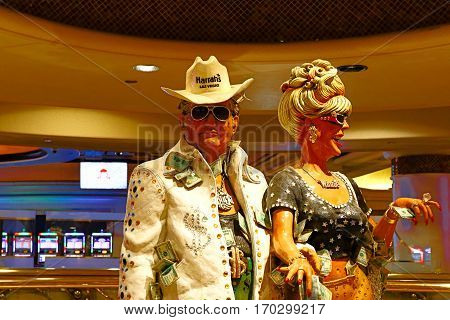 Las Vegas, NV, USA . Oct 10, 2016: couple statue of Harrah's Las Vegas hotel and casino. Harrah's is a hotel and casino owned and operated by Caesars Entertainment Corporation.