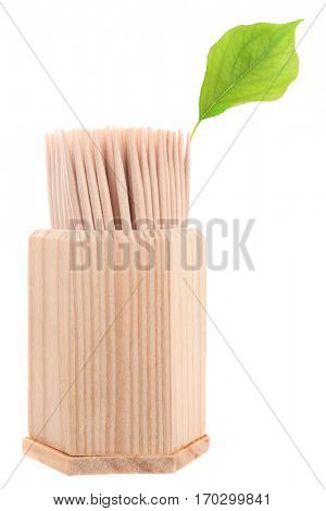 Table toothpicks in wooden box with green leaf