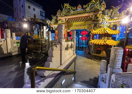 YOKOHAMA, JAPAN - NOVEMBER 7, 2016 : The Ma Zhu Miao temple in Chinatown district of Yokohama at night, Japan. Ma Zhu Miao is the largest Chinese temple in Yokohama, the largest Chinatown in Asia.