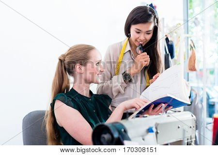 Tailors or fashion designer talk about pattern