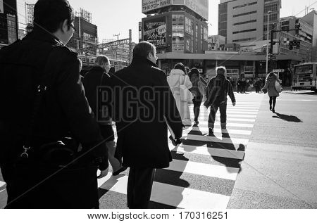 Shinjuku, Tokyo - January 7, 2014: Street view of Shinjuku. Shinjuku is a special ward located in Tokyo Metropolis, Population density of 17,140 people per km². January 7, 2014 in Tokyo, Japan.