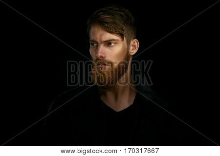 Closeup Portrait Of Bearded Handsome Man In A Pensive Mood Looking Away