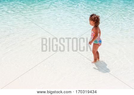 Young girl playing in a pool