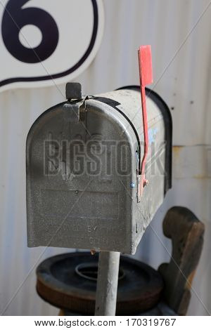 mail box. old mail box outside with red flag standing up.