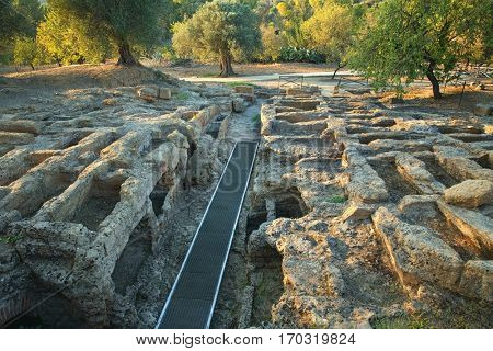 Shallow graves, the burial place of the first Christians carved into sandstone