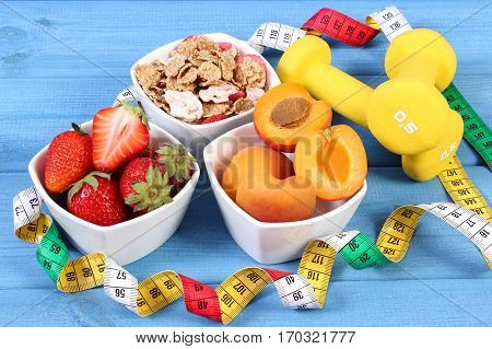 Fresh Fruits, Wheat And Rye Flakes, Dumbbells And Centimeter, Healthy And Sporty Lifestyle