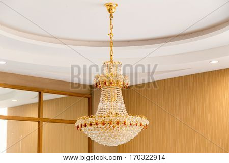 the crystal chandelier hanging in the hotel