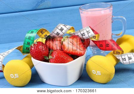 Fresh Strawberries, Milkshake, Dumbbells And Centimeter On Boards, Healthy And Sporty Lifestyle