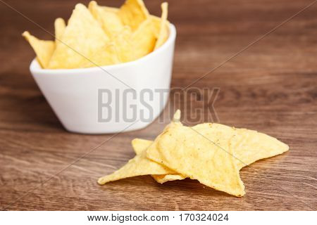 Salted Potato Crisps In Bowl On Board, Concept Of Unhealthy Food