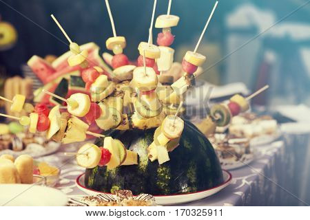 Fruits arrangement. Fresh various fruits elegant decoration.Wedding decoration with fruits in restaurant.