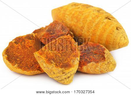 Close up of Dry turmeric over white background