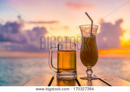 A glass of beer with Beautiful tropical Maldives island