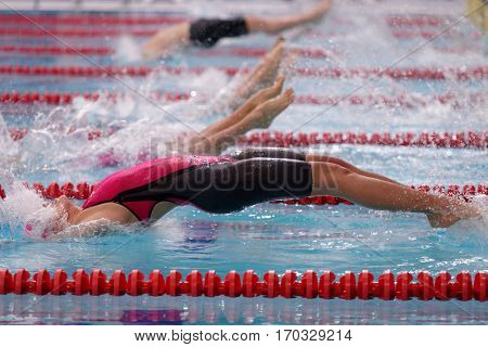 ST. PETERSBURG, RUSSIA - DECEMBER 17, 2016: Start of mixed gender medley relay 4 x 50 m during X Vladimir Salnikov Cup. Athletes from 6 countries participated in the competitions
