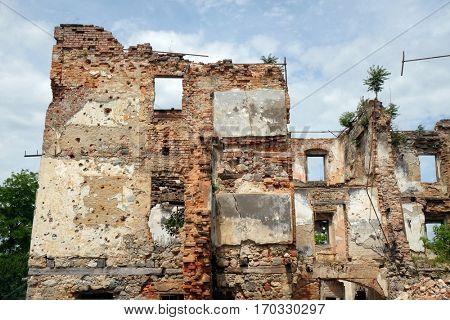 TURANJ, CROATIA - JUNE 11: Destroyed house, open air museum of the Croatian War of Independence, 1991 - 1995, (Homeland War, Domovinski Rat), Turanj, Croatia on June 11, 2016
