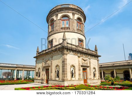 MEXICO CITY,MEXICO - DECEMBER 27,2016 : Beautiful gardens and the Caballero Alto tower on top of Chapultepec Castle in Mexico City