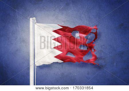 Flag of Bahrain flying against grunge background.