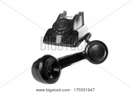 Old Vintage Retro Black Telephone Isolated on a white background . Selective focus