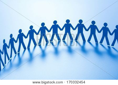 Paper people standing together hand in hand