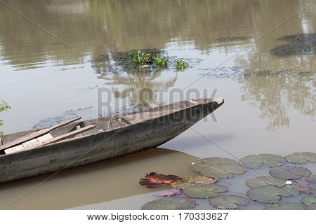 Wooden fishing boat ancient in river .