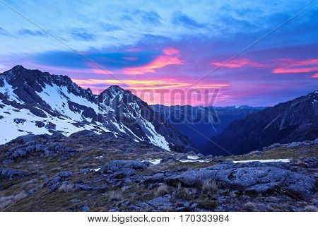 A Colorful Sunrise Illuminates Snowy Mountains.  Nelson Lakes National Park, Southern Alps, New Zealand