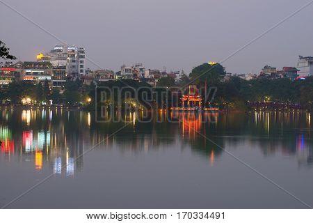 HANOI, VIETNAM - DECEMBER 13, 2015: Evening twilight on the Hoan Kiem lake