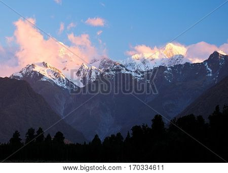 Mt Tasman and Mt Cook From Lake Matheson.  Fox Glacier, Westland National Park, New Zealand