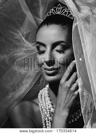 Black and white portrait of beautiful young bride.