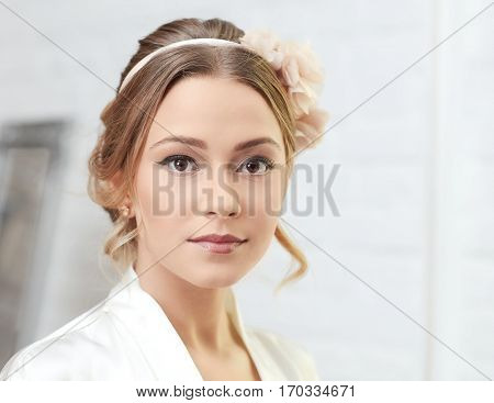 Closeup portrait of young blonde bride on wedding-day.