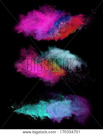 Explosion of colored powders, isolated on black background