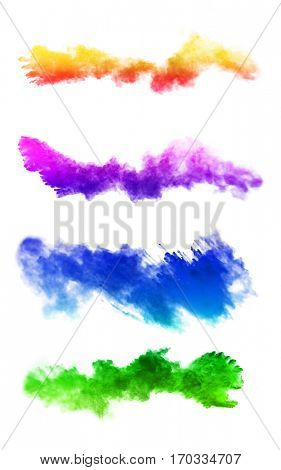 Explosion of colored powders, isolated on white background