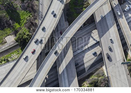 Aerial down view of Golden State 5 and Route 118 freeway interchange ramps in Los Angeles, California.